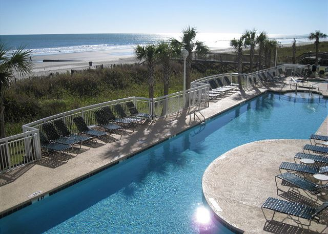 Resort style oasis with this great pool and sun deck