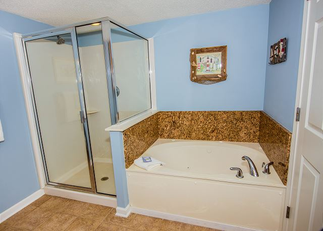 Bath linens are provided for your stay -- enjoy the jetted tub and glass enclosure shower at the end of the day.