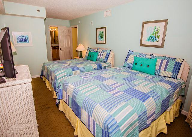 Guest bedroom includes a full en-suite private bathroom.