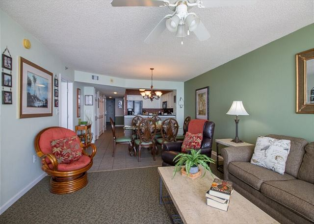 The spacious living room leads right out  to the oceanfront balcony