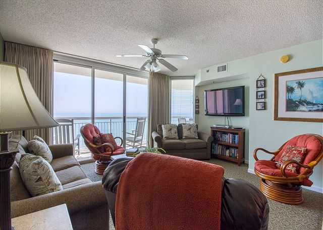 """The oceanfront living room features a 50 """" flat screen TV"""