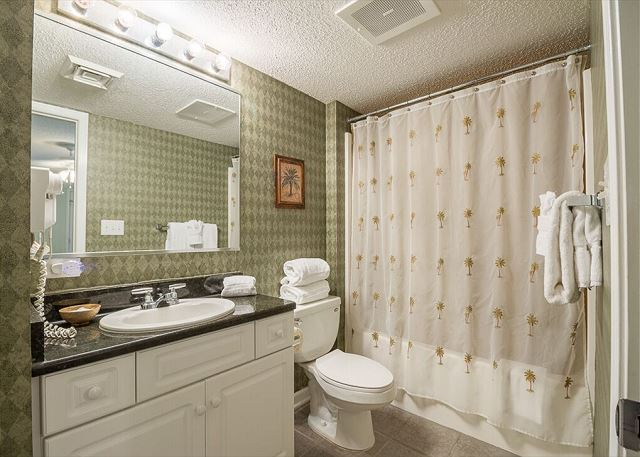 Bathrooms for each bedroom have a combination bathtub and shower