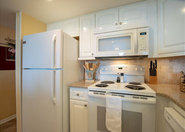 Everything is new 2017: appliances, tile floor, tile back splash, cabinets, quartz counter top, lighting, sink/faucet/disposal and paint.