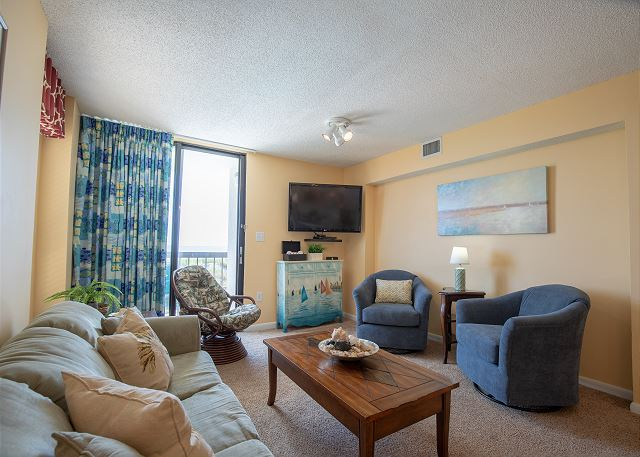 From this oceanfront end unit you can access the balcony  from the living room and the master bedroom.