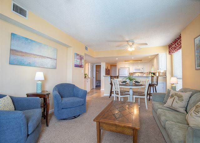 Living Room includes sofa (opens to Queen Sleeper) & 3 occasional chairs, flat screen TV, DVD player