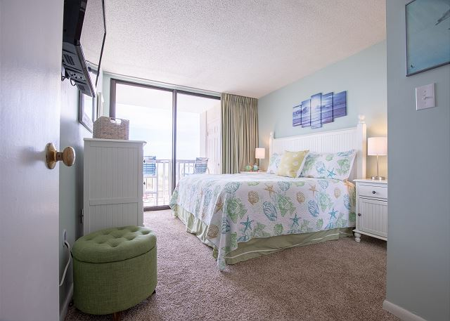 Master Bedroom: Balcony access to enjoy sounds of the ocean and views from the Balcony