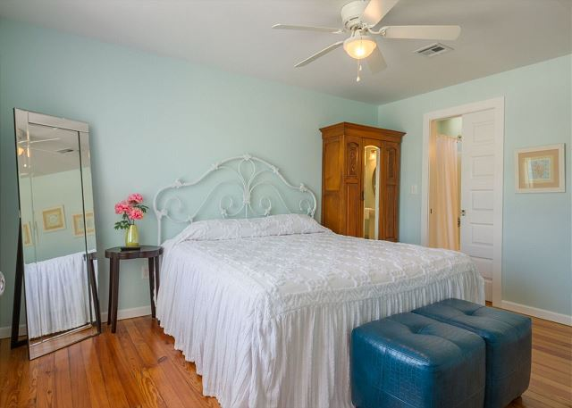 Upstairs king bed in guest room with shared bath.