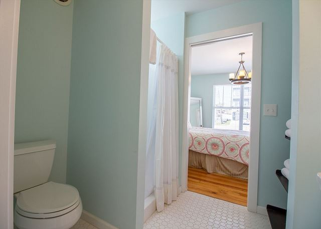 Bright and spacious bath shared by two guest rooms.