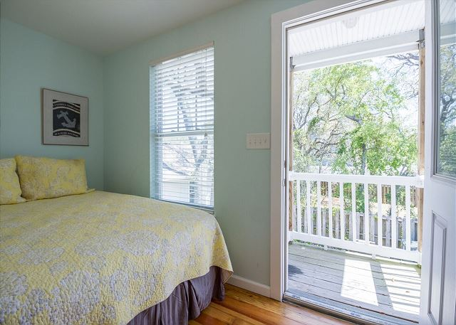 Upstairs guest room has a private walk out balcony.  Enjoy the tree top views.