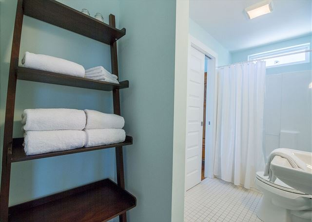 One of three shared bathrooms.  Tub and shower combo in this one.  All bed and bath linens provided.
