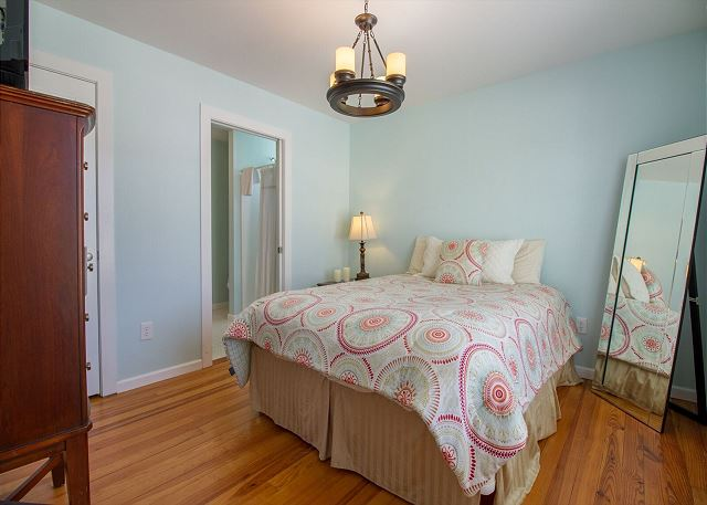 Downstairs guest room with queen bed.