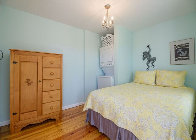 Upstairs guest room with queen bed.  Washer and dryer are tucked into this room too.