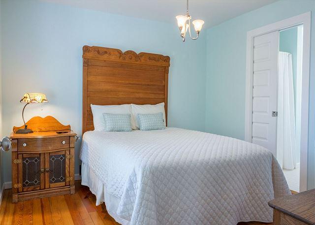 Upstairs guest bedroom with queen bed.