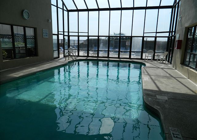 Resort features include an indoor pool with a glass wall and high ceilings to make the the pool & deck feel open and grand even on a rainy day.