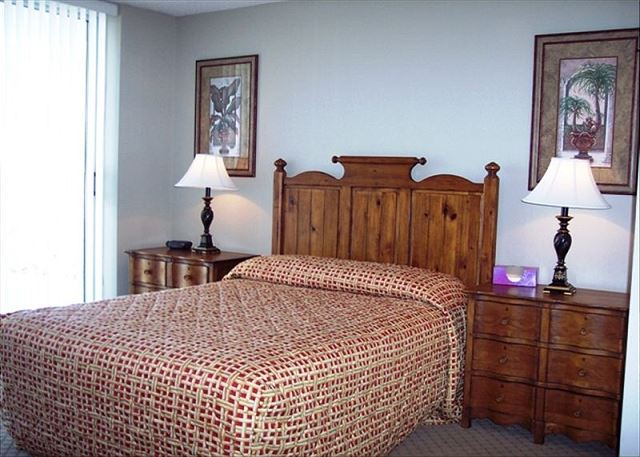 Another beautiful guest bedroom with queen bed and private balcony