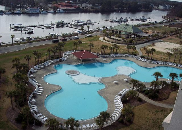 Expansive view of the salt-water resort pool and Intracoastal waterway & marina grill and bar.