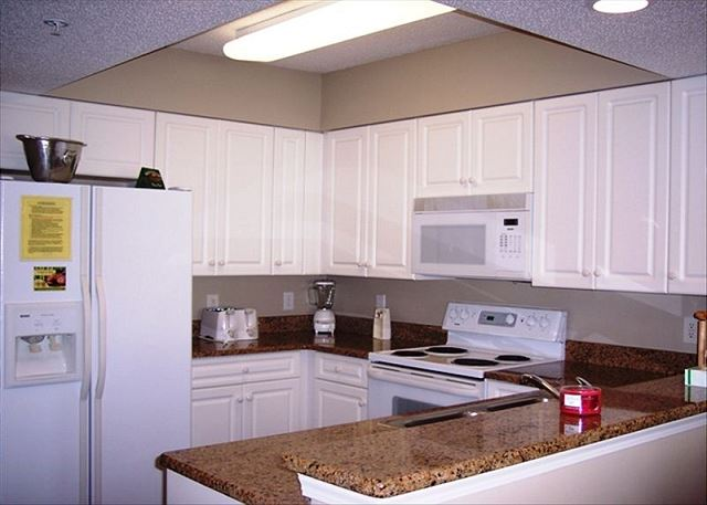 Updated kitchen with granite counter tops in and breakfast bar.
