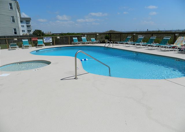 Outdoor pool with great sun deck and kiddie pool for the little ones.