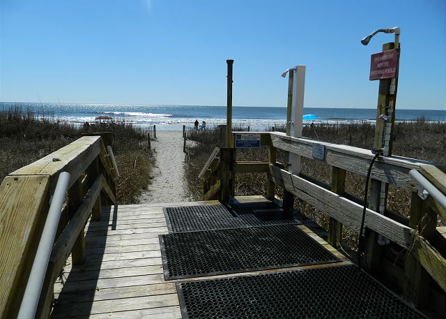Easy access walkway to the beach with shower to rinse off before going back up to the condo