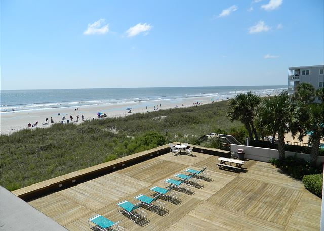Sunny view from the balcony overlooking the sundeck and beautiful Windy Hill dunes