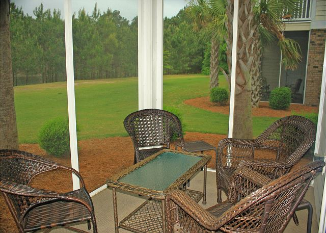 Nicely furnished screened in rear patio for relaxing.