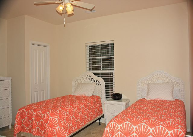 Spacious and colorful twin bedroom, all new wicker furniture and mattress