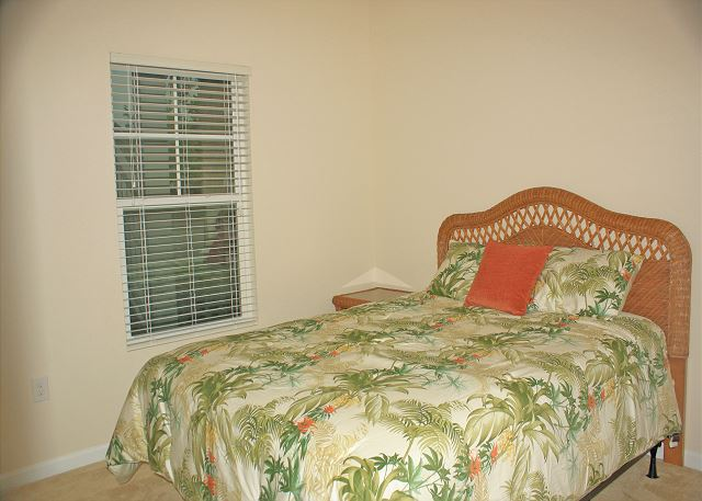 Guest bedroom with queen bed.  All new wicker furniture and mattress set.