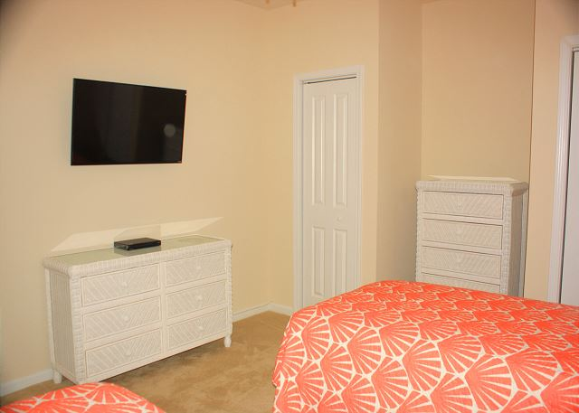 flat screen smart TV in the twin guest bedroom, perfect for the kids