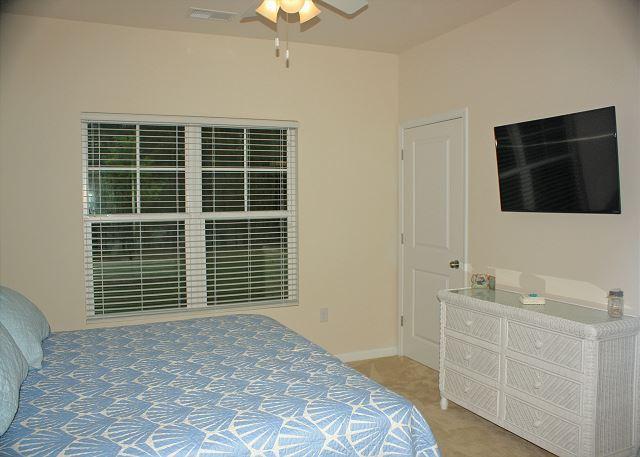 Master bedroom with flat screen smart TV