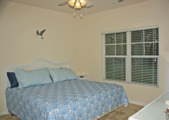 Lovely master bedroom with King bed and all new wicker furniture and mattress.
