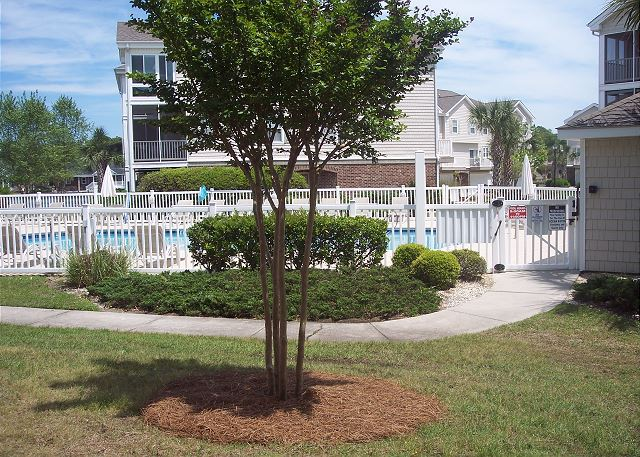 Beautifully landscaped grounds throughout this gated community.  Outdoor pools with plenty of seating