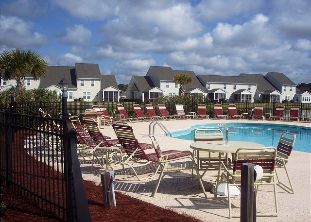 Lounge at the Heron Bay pool, just steps from your door