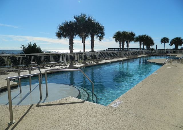 Crescent Shores offers beautiful landscaping around the pool and sundeck overlooking the dunes.