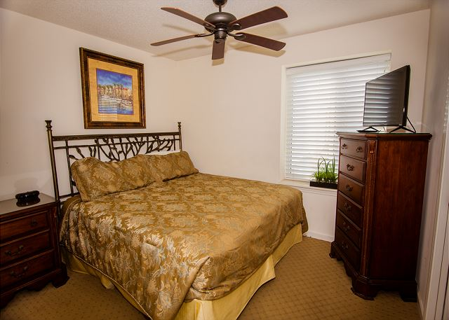 Guest bedroom offers a king bed to relax.