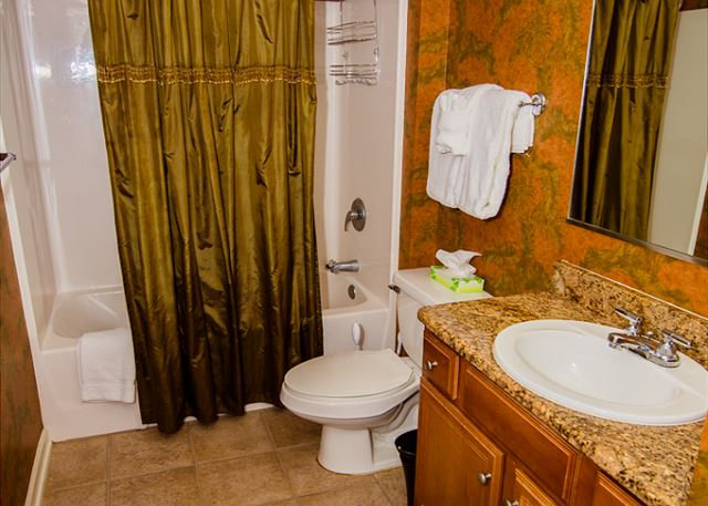 Fabulous modern guest bathroom fully stocked bath linens for your stay.