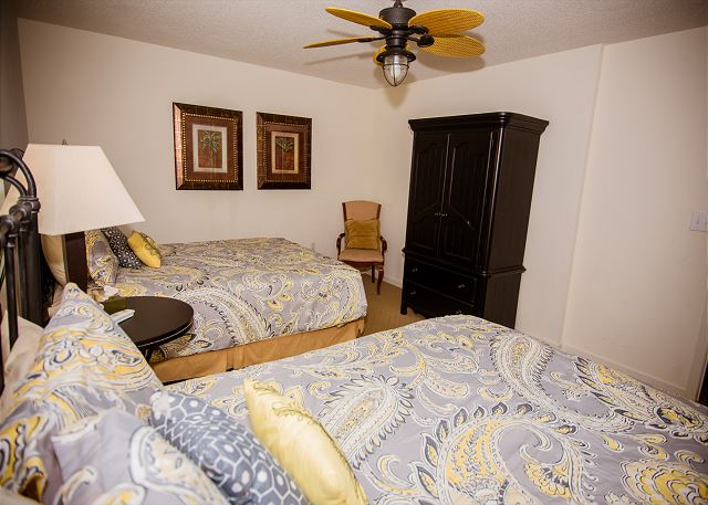 Super guest room with two queen beds -- room for a whole family to stay.