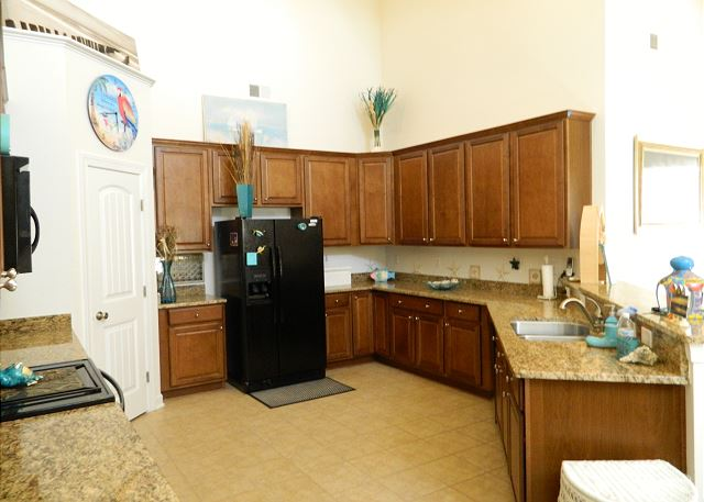 Beautiful open kitchen, granite counter tops, new appliances for preparing your gourmet seafood meals