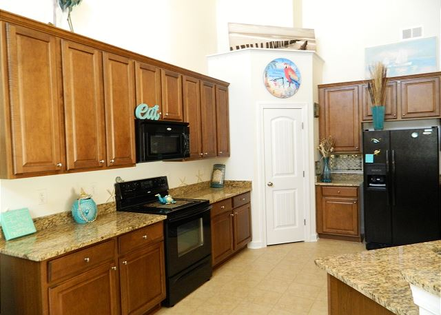 Large kitchen with granite counter tops, full size appliances and plenty of space for everyone