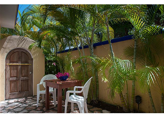 Enjoy a meal sitting in the peaceful space of your private courtyard.