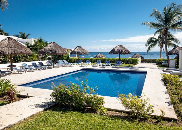 Clear, refreshing pool for lounging by the beach.  Loungers also on the beach.