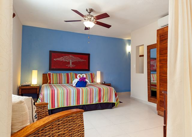 spacious and comfortable king size bed. Cool yourself with airconditioner and a celing fan.