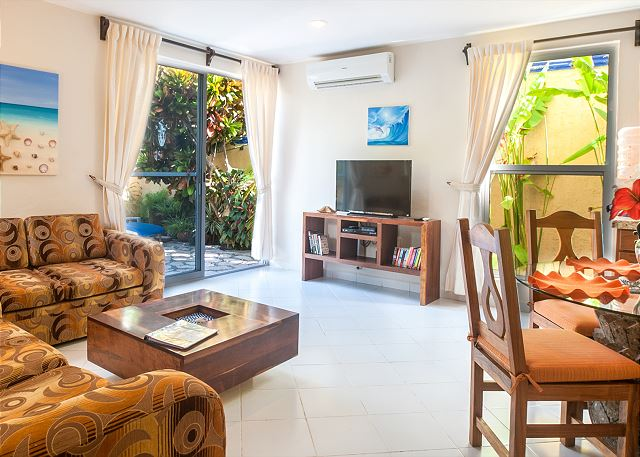 Spacious living room opening onto private courtyard.