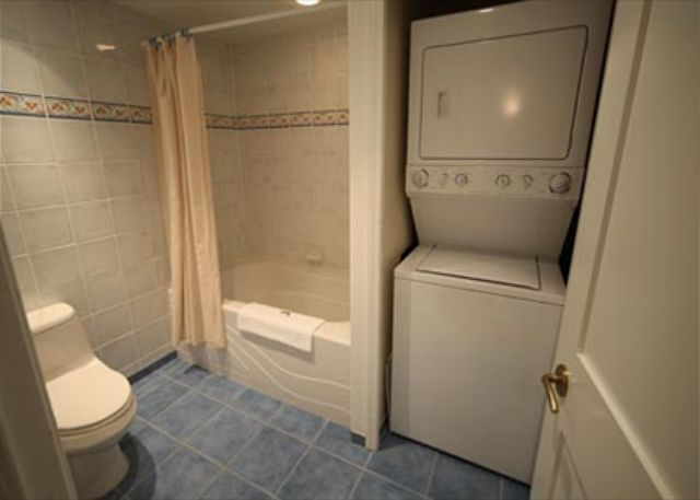Bathroom located on main floor showing washer & dryer.