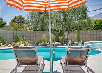 Poolside Chaise Loungers & Shade Umbrellas