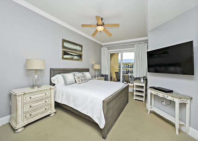 Master Bedroom has King Bed with sliding glass door that walks right out to your balcony.
