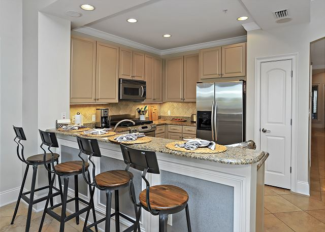 Kitchen Area with Bar Stools for Additional Seating