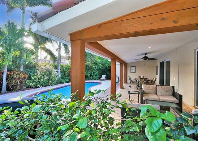 The large covered patio area allows you to enjoy the outdoors and the breeze.