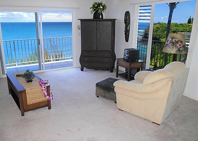 Living room and entertainment center with ocean views all around