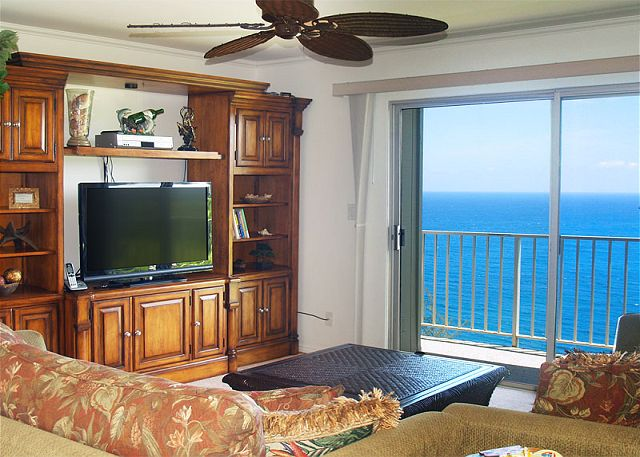 Living room and entertainment center with flat screen TV.