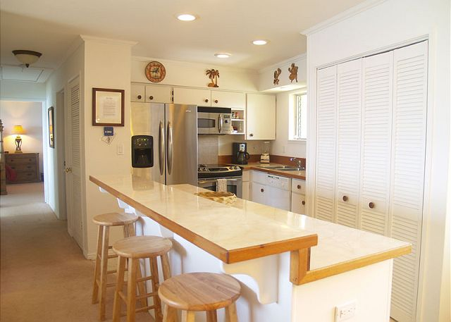 Newly remodeled modern kitchen with breakfast bar for three.
